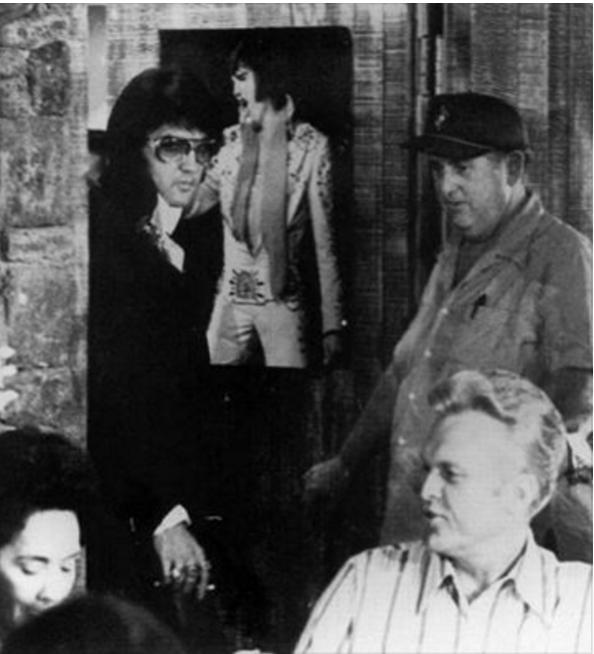 Elvis comparison to pool house door photo