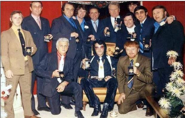Elvis group photo showing badges