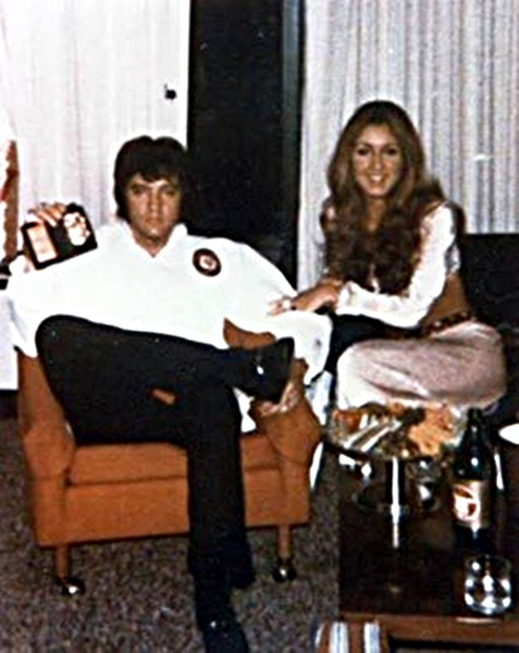 Elvis showing his Federal Agent Badge accompanied by Linda Thompson