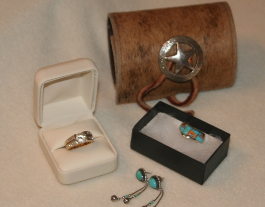 Jesse's gifts to linda and tom wrist wrap, ear rings and ring.