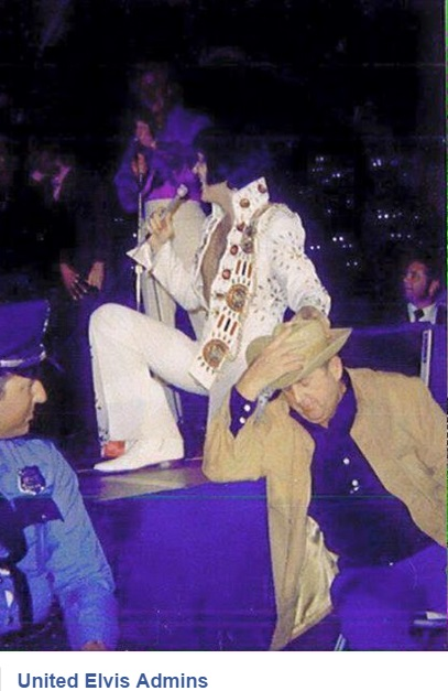 Elvis on stage with Col. Parker