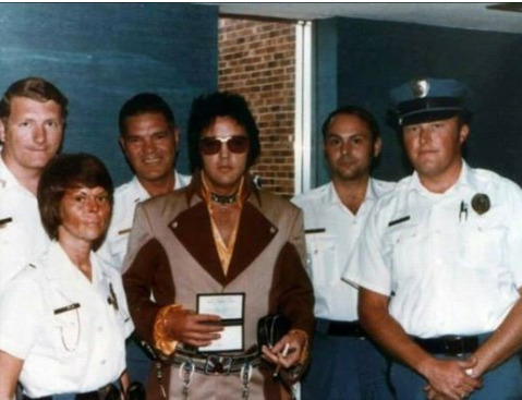 Elvis with officers holding his own credentials Lisa Sallee shared Betty Langham's photo.